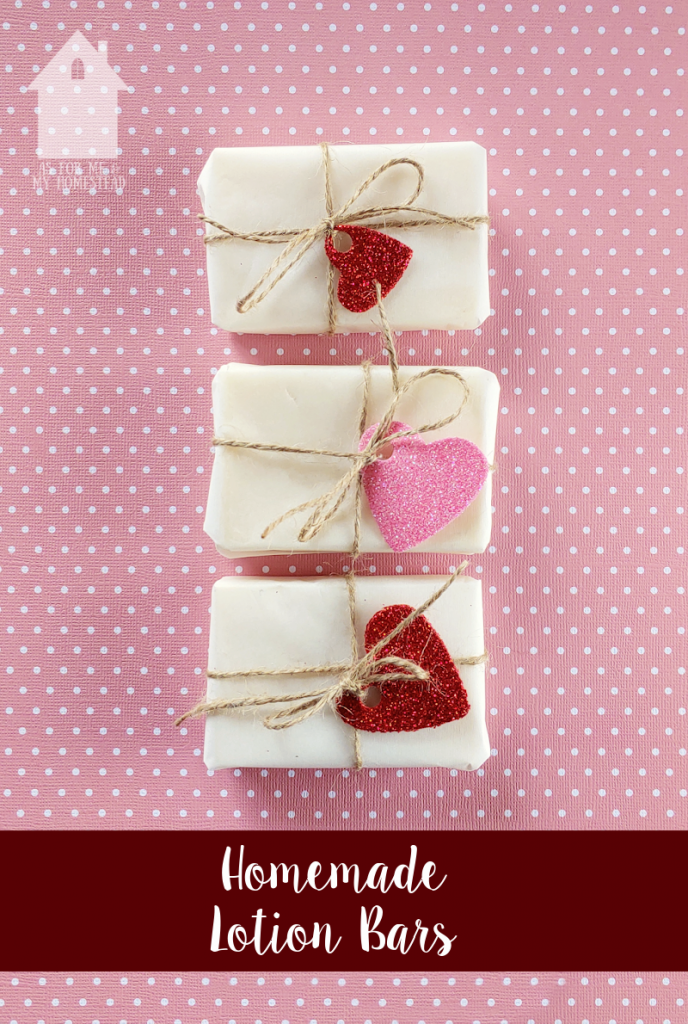Three homemade lotion bars wrapped in freezer paper, jute, and cute red and pink hearts